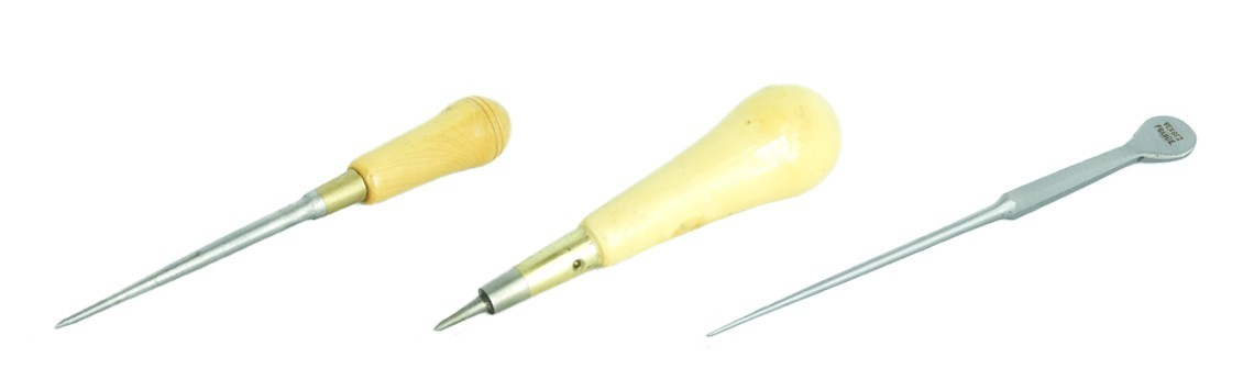 Upholstery regulators, awls
